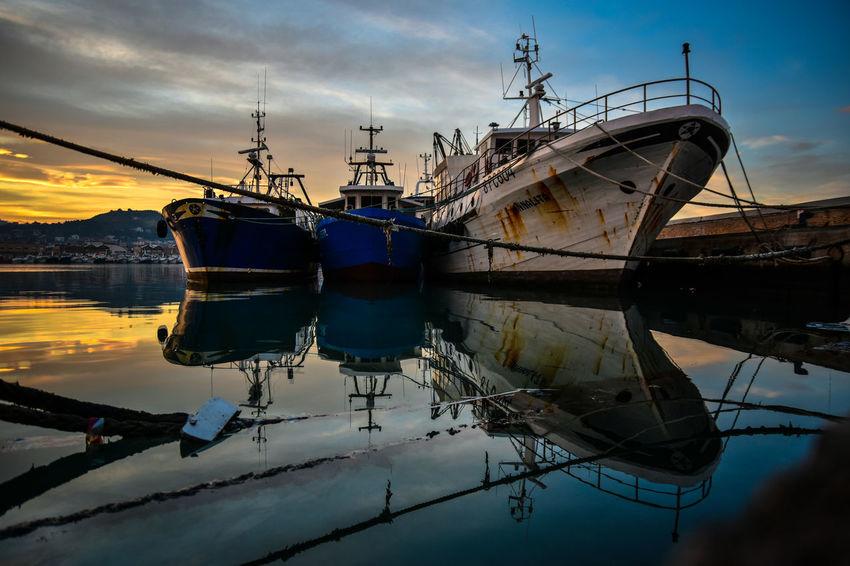 Fishing boats. Adriatic Sea Fishing Fishing Boat Fishing Industry Harbor Italy Mode Of Transportation Moored Outdoors Reflection Sailboat Ship Sky Sunset Tranquility Water The Street Photographer - 2018 EyeEm Awards