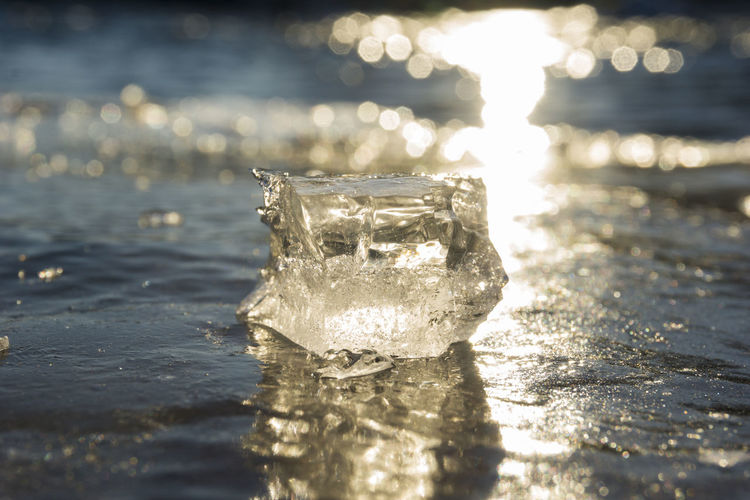 Closeup of an Ice Cube in the warm light of Sunset. Cube Frozen Ice Ice Cube Ice Layer Iced Layer Of Ice Layers Nature Reflections Sunset Transparent Winter Cool EyeEm Best Shots - Nature Eis Frühling