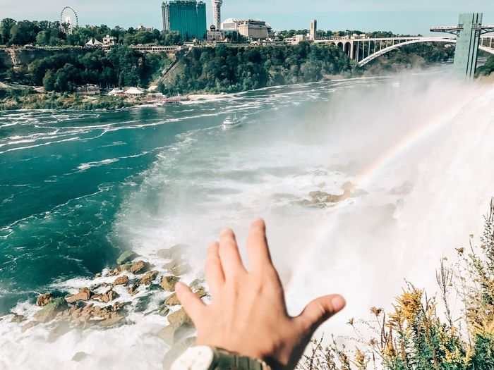 Catch the rainbow. Human Hand Real People Human Body Part One Person Personal Perspective Human Finger Water Outdoors Lifestyles Leisure Activity Day Motion Nature Beauty In Nature Close-up Sky People Niagara Falls Waterfall Landscape New York Weather Rainbow The Week On EyeEm