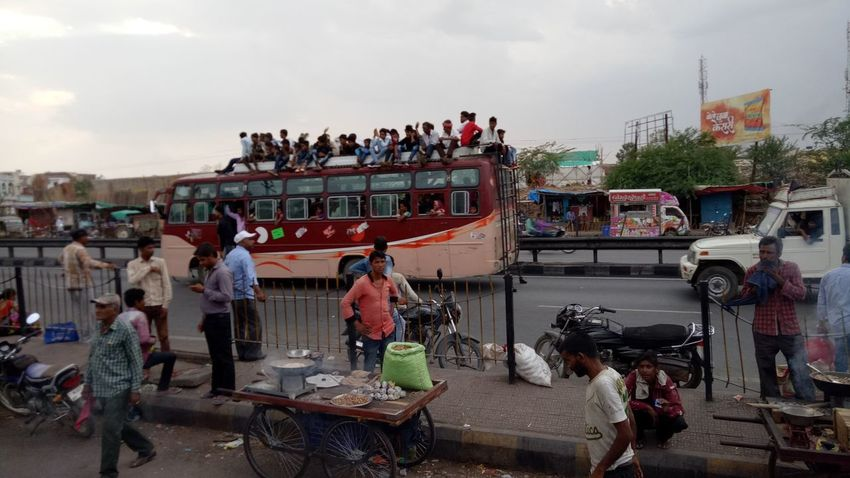 Large Group Of People People Crowd Adult Sky Outdoors Day Adults Only Many People Sitting On Bus Top Many People Motion