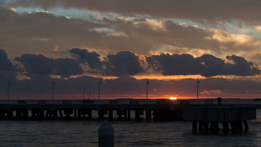 Key West Sunset Beauty In Nature Cloud - Sky Dramatic Sky Florida Key West Mallory Square Pier Silhouette Sunset Sunset_collection