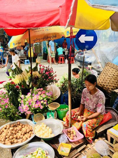 Morning market in Yangon. Moment Flowers Portrait Of A Woman Travel Photography Streetphotography Travel Variation Choice Retail  For Sale Real People Market Multi Colored Market Stall Business Women