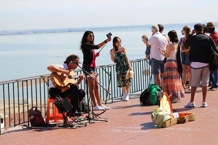 City Exceptional Photographs EyeEm Best Shots From My Point Of View Guitar Guitarist Large Group Of People Microphone Music Musical Instrument Musician My Year My View Outdoors People Person Railing Sitting Sky TakeoverMusic Taking Selfies Togetherness Tourism Tourists Water Woman