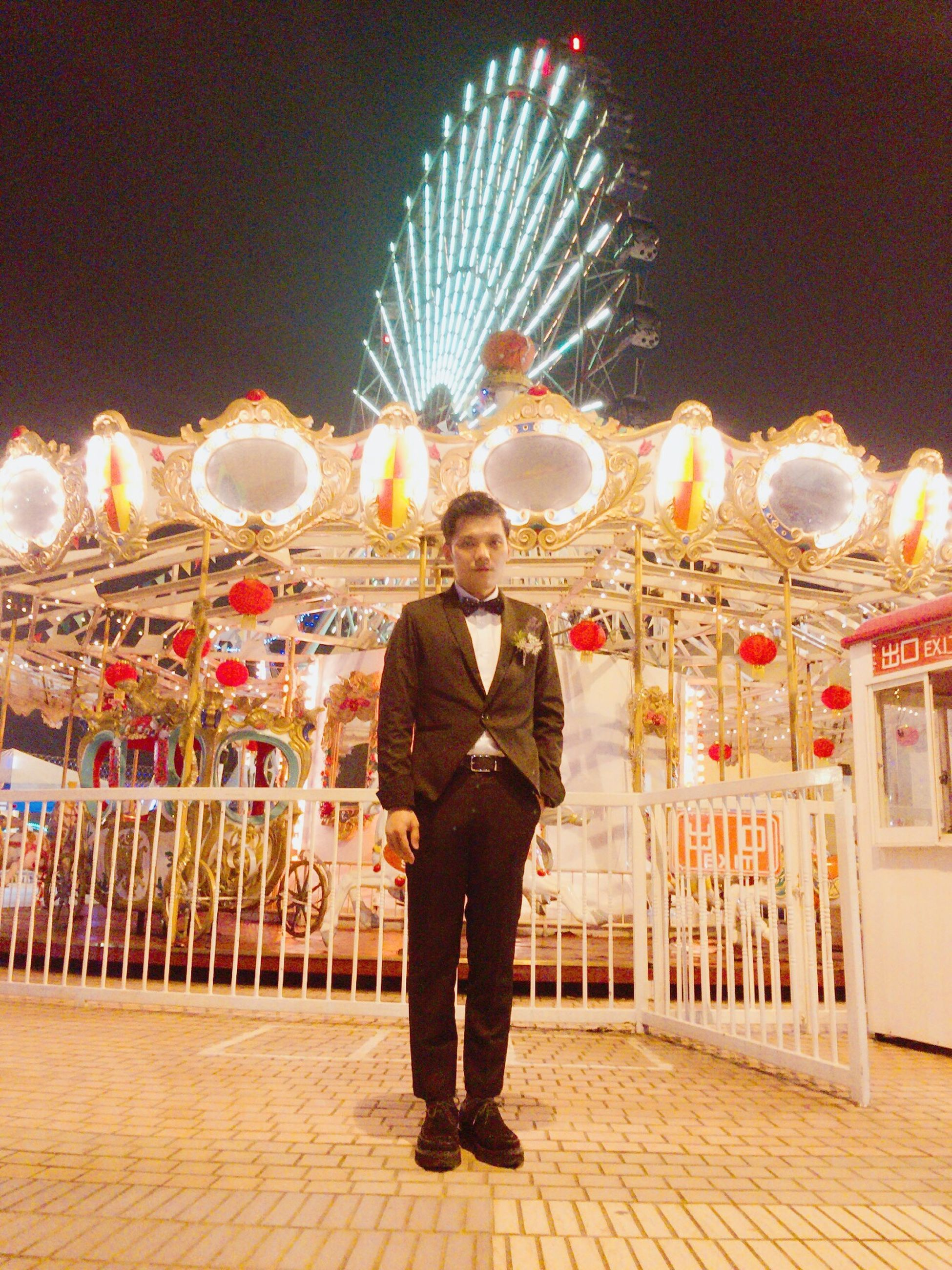 full length, celebration, adults only, travel destinations, night, ferris wheel, people, amusement park ride, sky, outdoors, adult, firework display, one person, only men, one man only