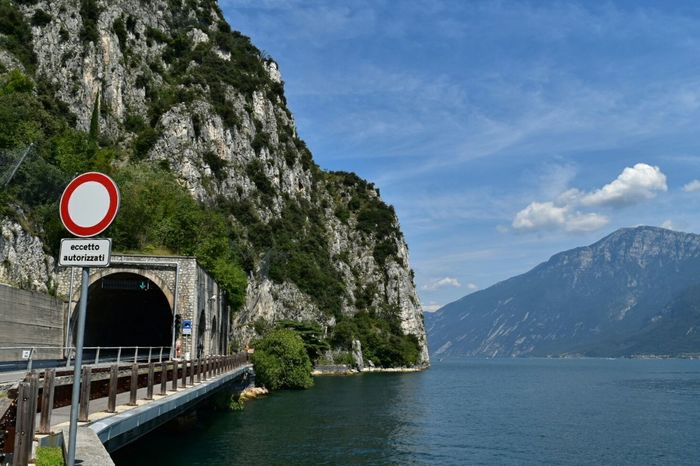 Tunnel around lake Garda Italy🇮🇹 Your Ticket To Europe Lakeview Tunnel Tunnels Tunnel Entrance Rocks And Water Mountain Lake Mountain Pass Lake Garda Lago Di Garda Manmadestructures
