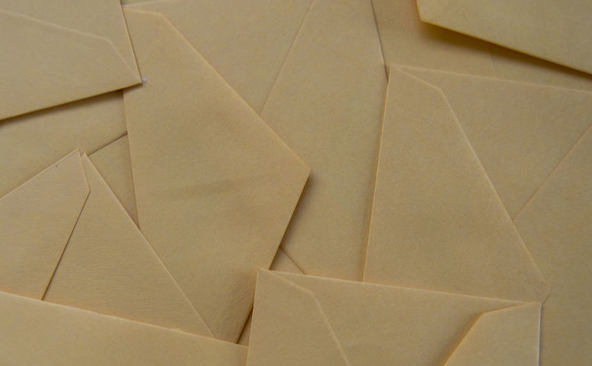 Background full of letters envelopes. Made of pastel orange paper. Letters Post Art And Craft Background Backgrounds Close-up Craft Envelope Envelopes Folded Full Frame Indoors  Large Group Of Objects Letter Mail Material No People Paper Pattern Recycling Send Shipping  Still Life Vintage Wrinkled