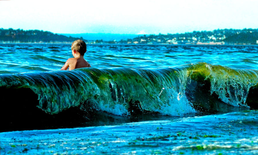 The Tourist in the Water at Alki Beach in Seattle. Pacific Northwest  Childhood Cityscapes City Happiness The Great Outdoors - 2016 EyeEm Awards Visual Stories Waves Crashing Surf's Up Waves Sunny Tourism Tourist Beach Swimming Saltwater Washington Environmental Seaweed Colorsplash Color Splash Live For The Story Perspectives On People