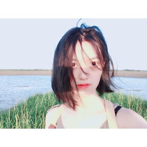 Sea Water One Person Horizon Over Water Beach Day Outdoors Nature Summer Beautiful Woman Real People Young Adult Young Women Grass Sky Close-up Adult People Adults Only