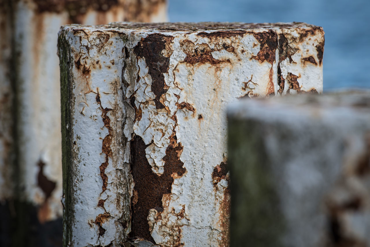 rusty, weathered, textured, focus on foreground, close-up, day, damaged, no people, outdoors, nature