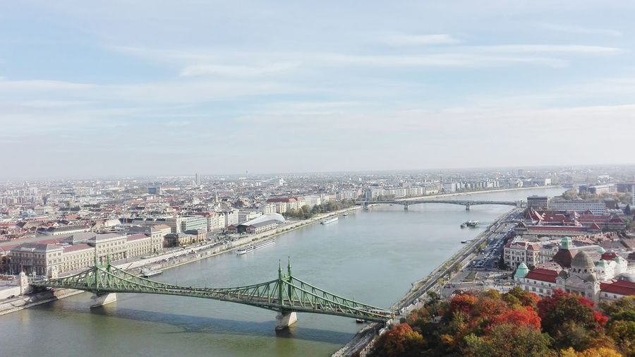Cityscape Bridge - Man Made Structure Architecture City Travel Destinations River Aerial View Built Structure Suspension Bridge High Angle View Outdoors Sky No People Ferris Wheel Skyscraper Day Water Urban Skyline Budapest Budapest, Hungary Budapest Love Building Exterior