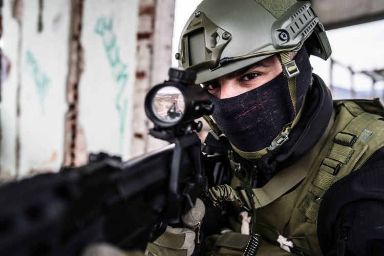 Government Military Weapon Armed Forces Clothing Uniform Gun Portrait Protection Men Military Uniform Looking At Camera Security One Person Machine Gun Protective Workwear Adult Police Force War Aggression  Special Forces
