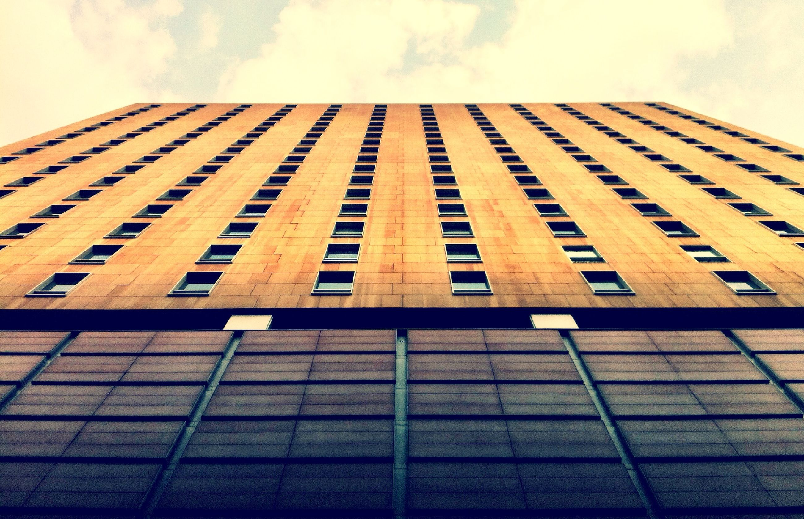 architecture, building exterior, built structure, low angle view, sky, modern, office building, building, glass - material, window, city, tall - high, reflection, cloud - sky, skyscraper, tower, day, pattern, outdoors, no people