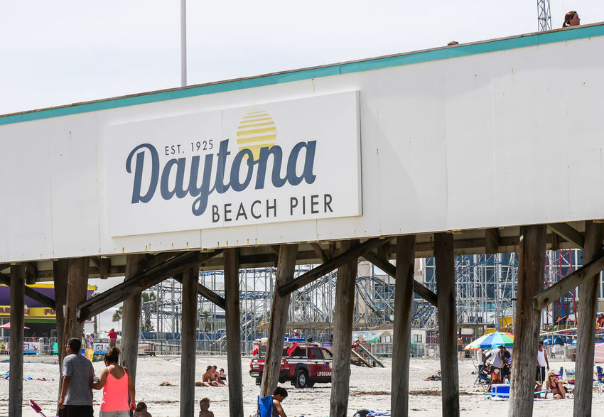 DAYTONA BEACH, FLORIDA - APRIL 15, 2017: The famous historic Daytona Beach Pier is a popular vacation spot to visit during holiday weekends. Photo taken during Easter weekend. Daytona Beach Family Famous Holiday Beach Beachgoers Daytona Beach Pier Easter Weekend  Historic Lifestyles Men Outdoors People Popular Sunshine Vacation Women EyeEmNewHere