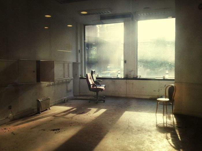 Empty chair in abandoned interior