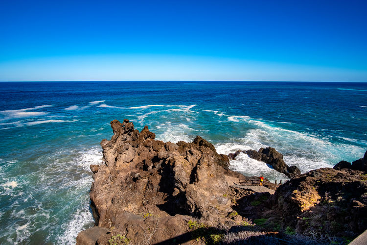A sunny autumn day on the Atlantic coast - San Juan de la Rambla San Juan De La Rambla Tenerife Teneriffa Canary Islands SPAIN Atlantic Ocean North Coast Travel Destinations Travel Stone Surf Splashing Rocky Bay Seascape Shore Wave Coastline Rocks Landscape Beach Coast Ocean Waves Clouds Sea Water Horizon Over Water Beauty In Nature Scenics - Nature Horizon Rock Sky Blue Rock - Object Solid Tranquil Scene Nature Land No People Motion Tranquility Idyllic Outdoors Turquoise Colored Rocky Coastline Breaking