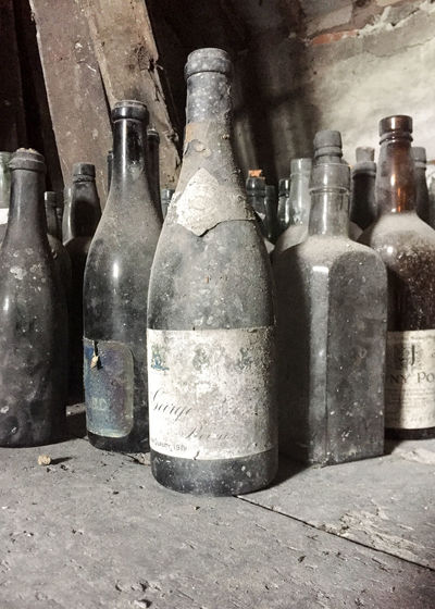 Attic Finds Forgotten Abandoned Attic Bottle Choice Close-up Container Day Dirty Dust Empty Forgotten Things Glass - Material In A Row Indoors  Metal No People Obsolete Old Side By Side Still Life Table Transparent Variation