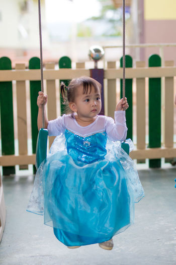 Ballet Dancer Cheerful Childhood Cute Day Elementary Age Front View Full Length Girls Happiness Indoors  Leisure Activity Lifestyles Looking At Camera One Person Performance Playing Portrait Preschool Real People Smiling Standing