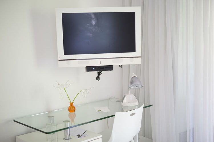 Television Over Glass Table In Living Room