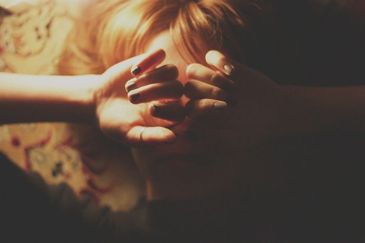 Close-Up Of Woman Covering Eyes With Hands