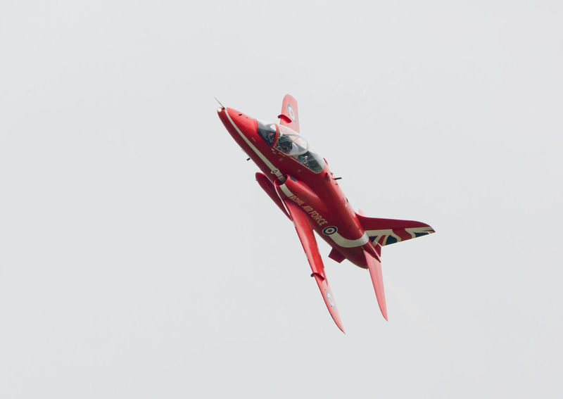 Single Red Arrow Air Vehicle Airplane Airshow Close-up Copy Space Day Fighter Plane Flying Mid-air Military No People Outdoors Red Red Arrows Studio Shot White Background