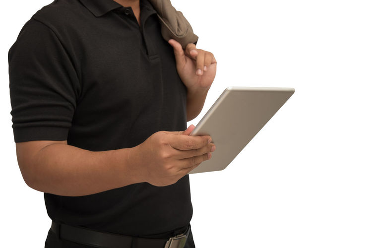 Midsection Of Businessman Using Digital Tablet While Standing Against White Background