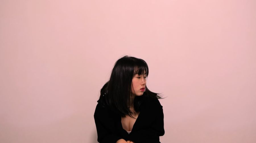 Sad Young Woman Against Pink Background