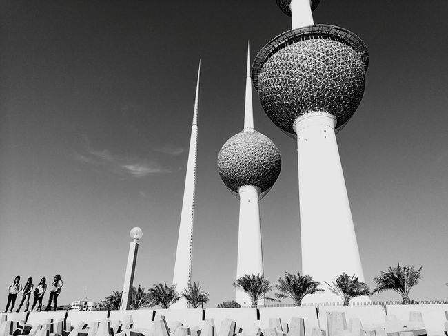 Low Angle View Kuwait Towers Landscape Landmark Tower Bonding Friendship Standing Together Lifestyles Looking At Camera Group Of People Concretewalls Dayshots Outdoors Scenics monochrome