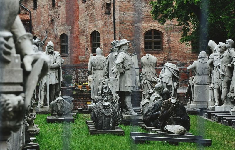 Petrified Stone Statues Spandau Citadel Berlin Medieval Castle Statue Park Brick Wall Windows Grass Pallets Medieval Figures