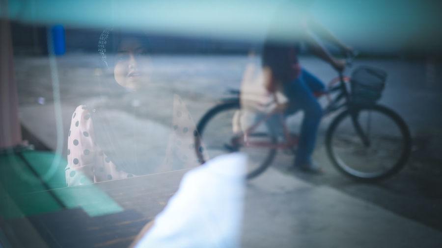 City Men Bicycle Window Close-up