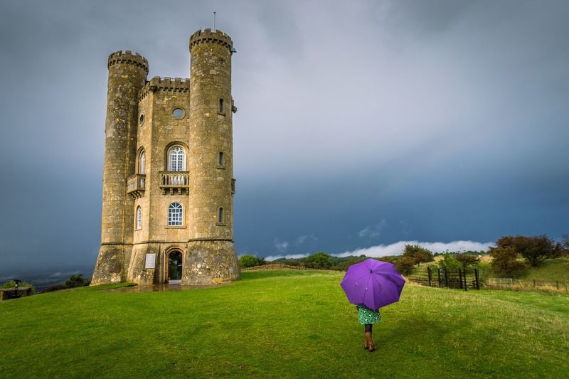 Brollies at Broadway Architecture Built Structure Building Exterior Full Length Grass Sky Tower Tourist Cloud - Sky Day Footpath Person Outdoors Medieval Green Color Tourism History My Year My View
