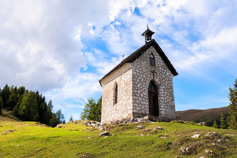 The little church on mountain small village. Religion building Architecture Sky Built Structure Cloud - Sky Building Exterior Place Of Worship Religion Building Nature Landscape Land Field Belief Spirituality Grass Day Plant No People Outdoors Mountains