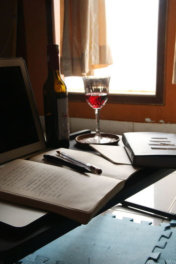 Glass of laptop on table