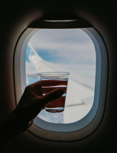 Holding glass of water in the airplane