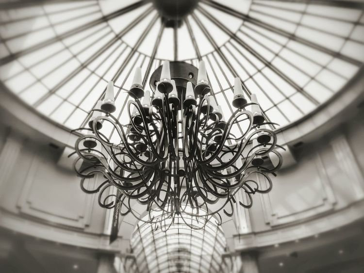 Chandelier Low Angle View No People Indoors  Day Close-up Building Interior Iron Structure Chandelier Light Vintage Photo Dome Built Structure Architecture Black And White Decoration Lights Best Eyeem Edits Decorative Art Natural Illumination Old Buildings Old Times Perspective Symmetry The Architect - 2017 EyeEm Awards
