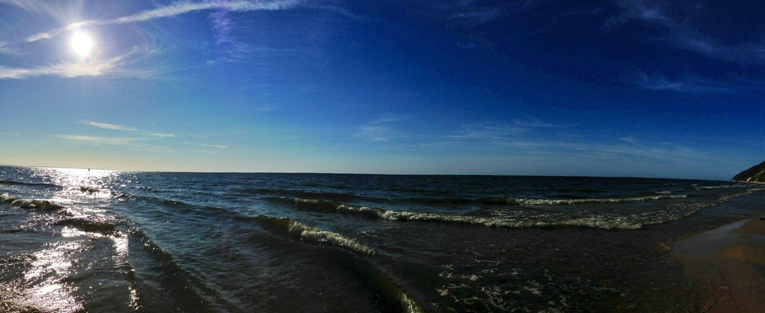 sea, horizon over water, water, beach, sky, tranquil scene, scenics, tranquility, beauty in nature, shore, blue, nature, idyllic, sand, coastline, wave, sunlight, panoramic, cloud - sky, cloud