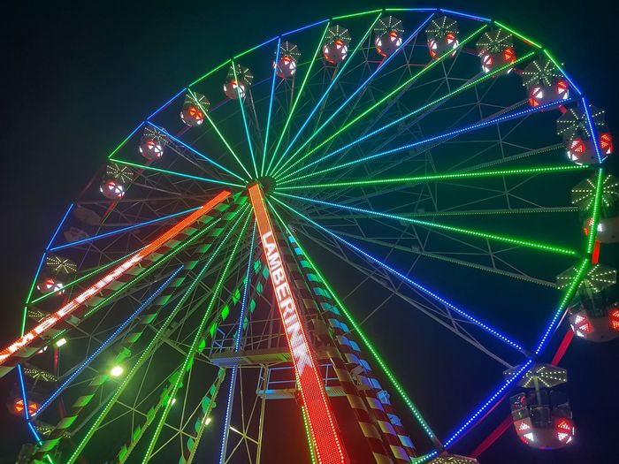Illuminated Ferris Wheel Multi Colored Arts Culture And Entertainment City Sky Carousel Rollercoaster Traveling Carnival Skyscraper Settlement Fairground Tower Coney Island Entertainment Light Trail Financial District  Office Building Carousel Horses Firework Display Skyline Rainbow Lorikeet High Rise Tall Spire  Urban Scene Colored Pencil Colorful City Location