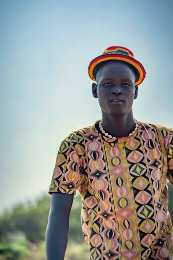 Tribe Travel Africa Omo Valley Tribal Ethiopian Photography 🇪🇹 Ethiopian Portraits Portrait Photography African One Person Sky Lifestyles Standing Young Men Real People Young Adult Casual Clothing Front View Waist Up Leisure Activity Nature Portrait Day Looking Away Clear Sky Looking Sunlight Outdoors Teenager