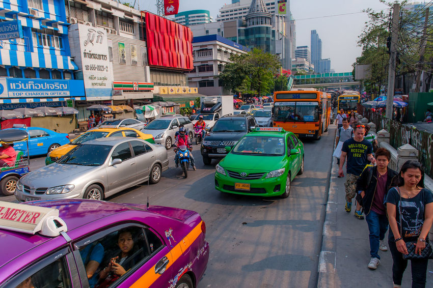 Heavy Traffic in one of the main street in Bangkok Adult Adults Only Architecture Bangkok Busy Street Bangkok Street Bangkok Streetp Bangkok Taxi Bangkok Thailand. Bangkok Traffic Building Exterior Car City Day Land Vehicle Multi Colored Outdoors People Sky Transportation