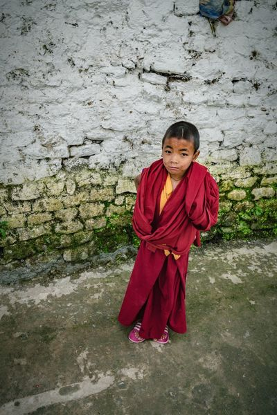 Tibet Tibetan Monks Tibetan Buddhism Tibetan Culture Child Looking At Camera Portrait Red Smiling Full Length One Person Boys Children Only Childhood Religion One Boy Only Front View Standing India Real People Arunachal Pradesh Outdoors People Adult Tawang EyeEmNewHere An Eye For Travel