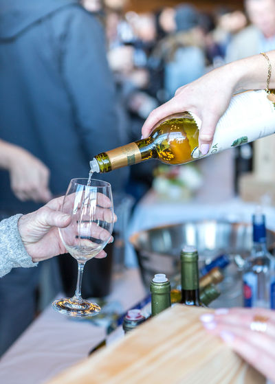 Wine being poured Alcohol Bartender Bottle Close-up Day Drink Drinking Glass Focus On Foreground Food Food And Drink Freshness Holding Human Body Part Human Hand Incidental People Indoors  Leisure Activity Lifestyles Men Midsection People Pouring Real People Refreshment Women