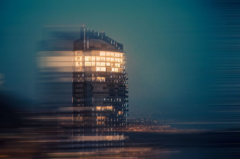 Humanity Meets Technology Capture Tomorrow Blurred Motion Motion Built Structure Illuminated Sky Long Exposure Architecture Water Building Exterior Nature No People Night Dusk Reflection Outdoors Speed Waterfront Office Building Exterior Sea Skyscraper My Best Photo