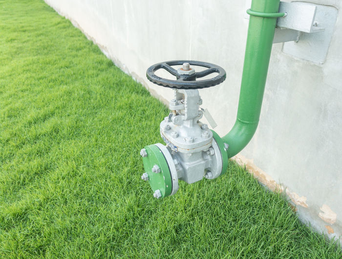 Close-up Day Environment Equipment Field Fuel And Power Generation Gardening Grass Green Color High Angle View Industry Irrigation Equipment Land Lawn Machine Valve Machinery Metal Nature No People Outdoors Plant Technology