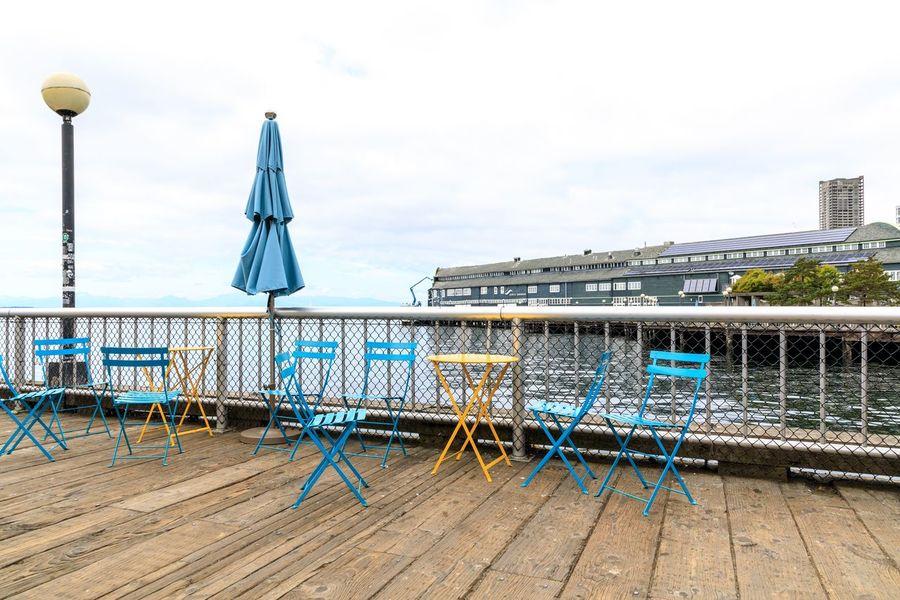 Seattle Dock Pier Sky Day Nature Land Seat No People Blue Chair Outdoors Built Structure Building Exterior Side By Side Railing Beach Group Of Objects Absence