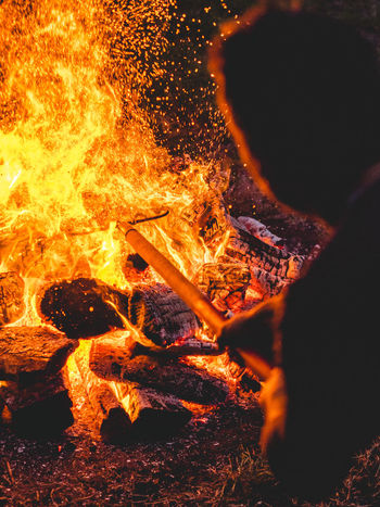 Stoking the Flames Flames Fire Fire Tending Stoke Burning Wood Blaze Fire Control
