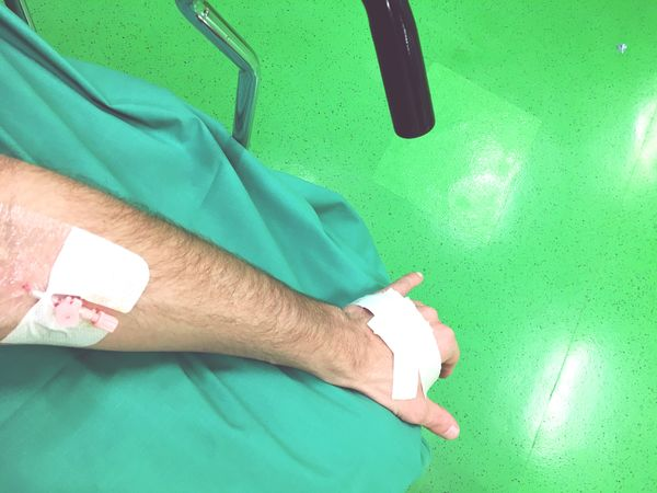 Human Leg Green Color One Person Real People Human Body Part Healthcare And Medicine Men Indoors  Hospital Patient Human Hand One Man Only Close-up Adult Adults Only People Accident Catheter Blood Hospital