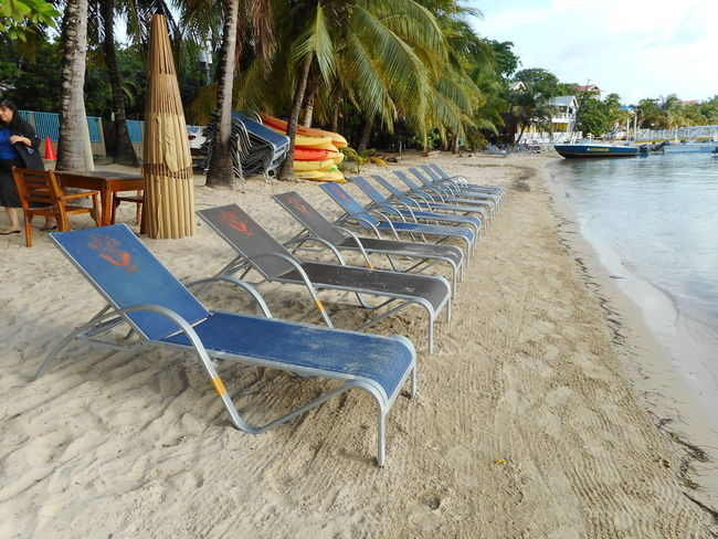 Honduras Roatan Absence Bay Islands Beach Beauty In Nature Chair Day Nature No People Outdoor Chair Outdoors Palm Tree Relaxation Sand Scenics Sea Seat Sky Sun Lounger Tranquil Scene Tranquility Tree Vacations Water