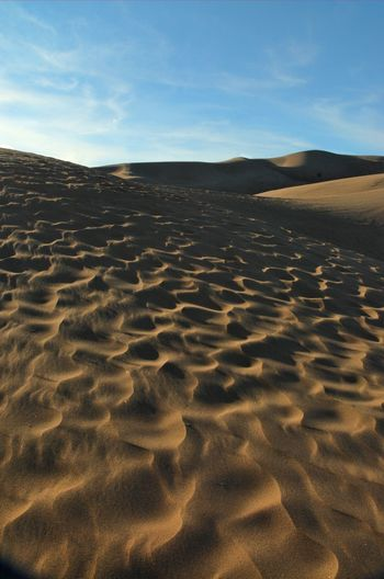 Idyllic shot of sand dunes in desert