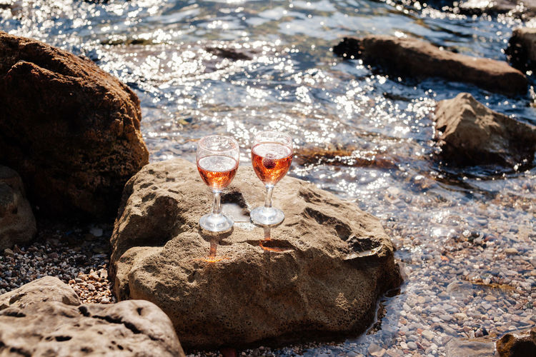 two martini glasses on beach Champagne Champagne Glasses Food And Drink Martini Alcholic Beverage Alcohol Alcoholic  Alcoholic Drink Beach Beachphotography Drink Drinking Glass Leisure Activity Martini Glass No People Outdoors Sea Seascape Vine Vine Glass Water