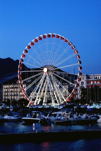Panoramic Wheel Salerno Italy Southitaly Ferris Wheel Arts Culture And EntertainmentPanoramic Wheel Amusement Park Clear Sky No People Sky Blue Nig Amusement Park Ride Built Structure Outdoors Water Illuminated Sea Building Exterior Nature City EyeEm Ready   EyeEmNewHere AI Now Business Stories An Eye For Travel The Graphic City Mobility In Mega Cities Colour Your Horizn Stories From The City Adventures In The City Going Remote Visual Creativity Plastic Environment - LIMEX IMAGINE The Architect - 2018 EyeEm Awards The Street Photographer - 2018 EyeEm Awards The Great Outdoors - 2018 EyeEm Awards The Traveler - 2018 EyeEm Awards