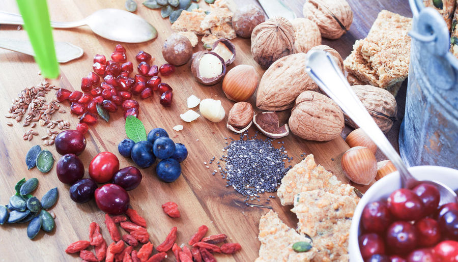 Close-up of fruits and seeds with nuts on wooden table